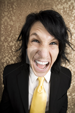 Screaming young man stock photo, Screaming young man in a business suit and tie by Scott Griessel