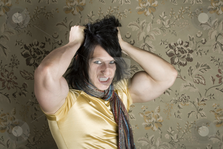 Frustrated Muscular Young Man stock photo, Frustrated Muscular Young Man Pulling Out His Black hair by Scott Griessel