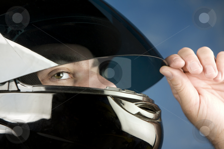 Man in a motorcycle helmet stock photo, Close-up of a man wearing a motorcycle helmet by Scott Griessel