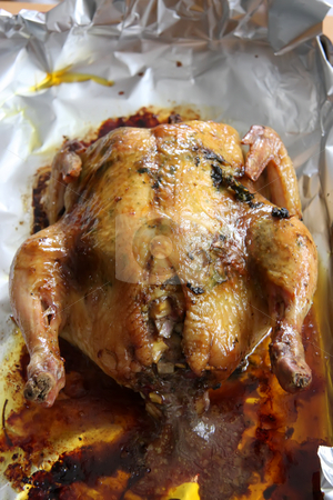 Whole roast chicken stock photo, Whole roast chicken wth stuffing in aluminum foil by Kheng Guan Toh
