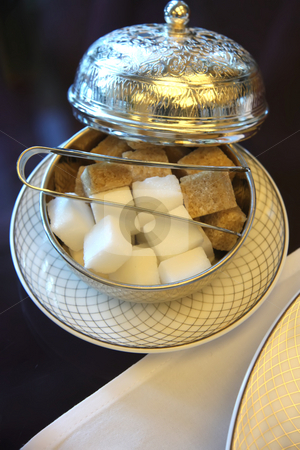 Silver sugar holder stock photo, Elegant silver holder with sugar cubes for traditional English teatime by Kheng Guan Toh