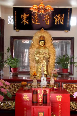 Toh Kheng Guan stock photo, Golden statue of Kuan Yin godess of mercy by Kheng Guan Toh