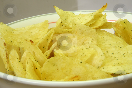 Potato chips stock photo, Seasoned fried potato chips in white bowl by Kheng Guan Toh