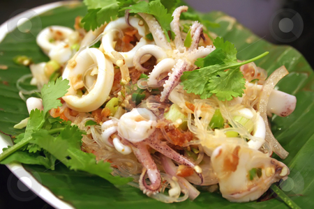 Thai salad stock photo, Thai seafood salad with squid over green leaf by Kheng Guan Toh