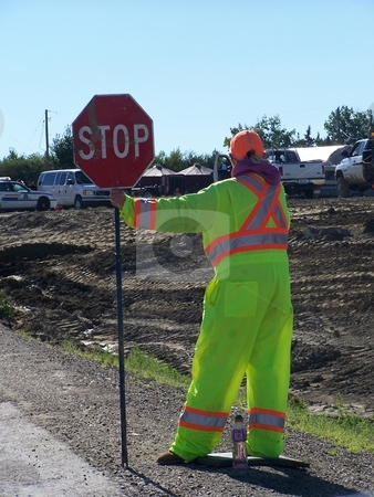 Woman Flagman On Road Construction Site stock photo, Woman Flagman On Road Construction Site by CHERYL LAFOND