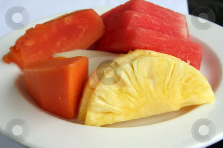 Sliced fruit stock photo, Sliced tropical fruit plate with pineapples, watermelon, and papayas by Kheng Guan Toh