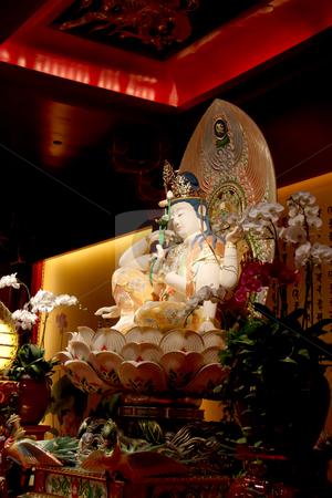 Kuan Yin statue stock photo, Statue of buddha inside a chinese temple by Kheng Guan Toh