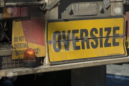 Oversize load stock photo, Sign on the back of an oversize truck by Stephen Gibson