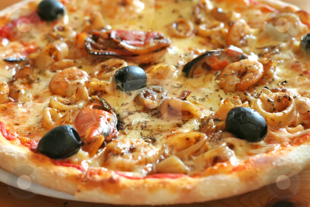 Seafood pizza stock photo, Traditional italian seafood pizza with prawns and mussels by Kheng Guan Toh