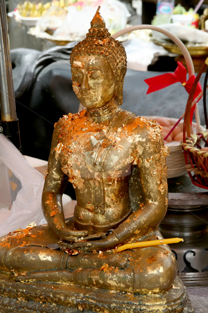 Thai Buddha stock photo, Statue of meditating buddha in Thai temple adorned with gold leaf by Kheng Guan Toh