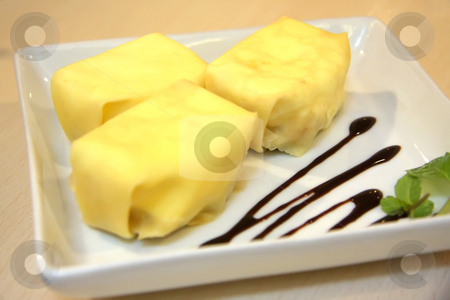 Stuffed crepe dessert stock photo, Fancy dessert of stuffed crepes on white plate by Kheng Guan Toh