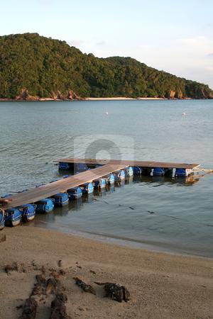 Tropical docks stock photo, Makeshift floating docks on tropical ocean beachside by Kheng Guan Toh