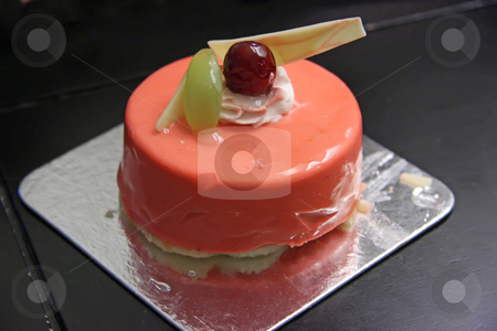 Strawberry mousse cake stock photo, Strawberry mousse cake round shape cream and grape decoration by Kheng Guan Toh