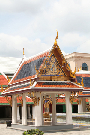 Thai temple courtyard stock photo, Ornate courtyard and building in Thai temple by Kheng Guan Toh
