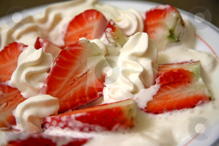 Strawberries and cream stock photo, Strawberries cut in half and covered in cream by Kheng Guan Toh
