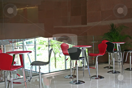 Modern cafe stock photo, Trendy modern cafe with red chairs and a balcony view by Kheng Guan Toh
