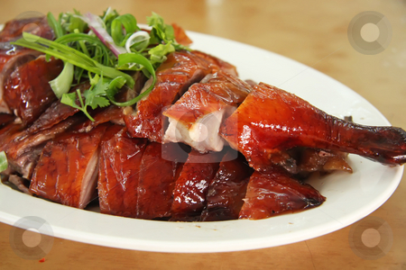 Roast duck stock photo, Roast duck chinese cuisine sliced portions on plate by Kheng Guan Toh