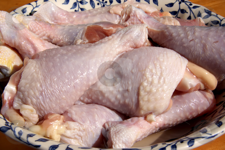 Raw chicken drumsticks stock photo, Raw chicken drumstick parts in pile in bowl by Kheng Guan Toh