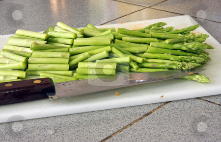 Sliced asparagus stock photo, Sliced fresh green asparagus stalks on chopping board by Kheng Guan Toh