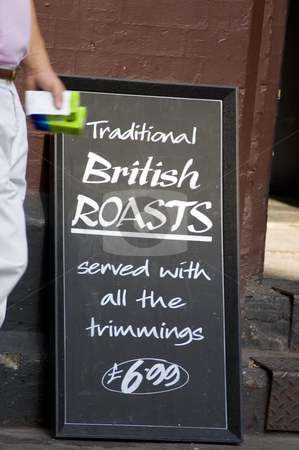 Signboard stock photo, Street signboard from a typical British restaurant by Lee Torrens