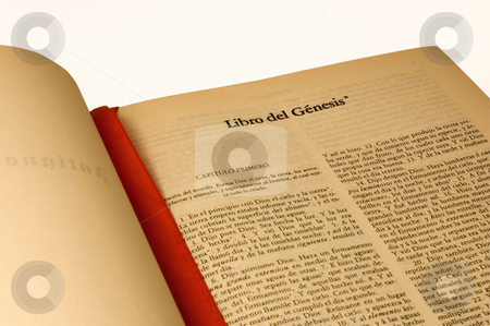 Spanish Bible isolated stock photo, A large open Bible in Spanish language, open to Book of Genesis. Isolated by Lee Torrens