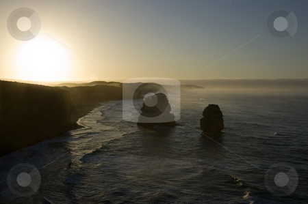 The Twelve Apostles at Sunrise stock photo, Australia's natural wonder, The Twelve Apostles - sandstone cliffs worn away by erosion. Taken at sunrise. by Lee Torrens