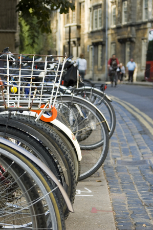 Bikes Parked in the Street (Oxford) stock photo, A row of bikes parked on the street in Oxford (England) by Lee Torrens
