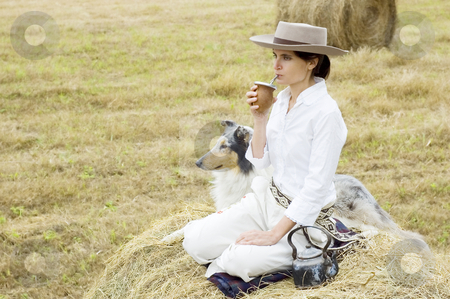 Farm Girl Drinking Mate stock photo, A young Argentinean farm girl relaxes with her dog and drinks her yerba mate by Lee Torrens