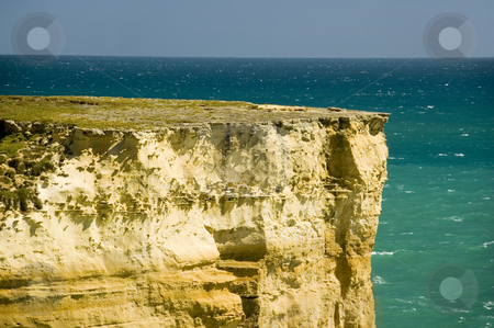 Ocean Cliff stock photo, Sheer cliff on the coastline by Lee Torrens