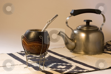 Yerba Mate Scene stock photo, An Argentinean Yerba Mate scene, including a kettle and a typical South American rug. Focus on Mate Gourd by Lee Torrens