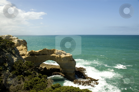 The Arch - Tourist attraction on the Great Ocean Road stock photo, The Arch, a natural rock formation created by erosion, is located on the Great Ocean Road in Australia by Lee Torrens