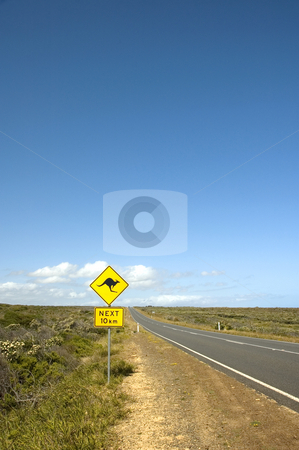 Kangaroo Sign by an Australian bush road stock photo, A sign warns motorists of the presence of kangaroos for the next 10 kilometers by Lee Torrens