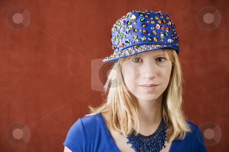 Teenage girl wearing a hat stock photo, Teenage girl wearing a hat with sequins by Scott Griessel
