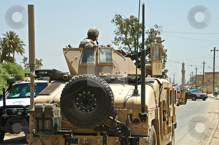 US Humvee on Iraqi road stock photo, A US humvee driving away from the camera on an Iraqi road by Stefan Edwards