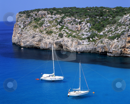 Peace stock photo, Two sail boats in the bay of Paleokastritsa on the greek island of Corfu by Paul Phillips