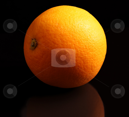 Whole Orange isolated on black reflective surface stock photo, A Whole orange isolated on a black reflective surface by Mark Allchin