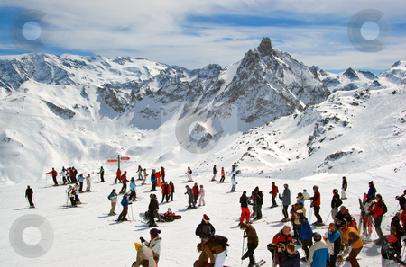 People skiing high in the Alps stock photo,  by Mark Smith