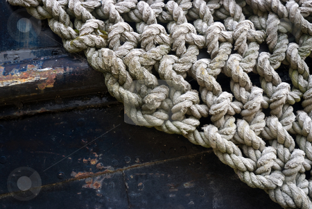 Woven rope stock photo, Abstract of woven rope on the bow of a old shil by Paul Phillips