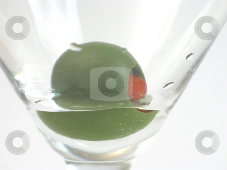 Olive stock photo, Olive with pimento at bottom of empty martini glass. by Clay Anthony