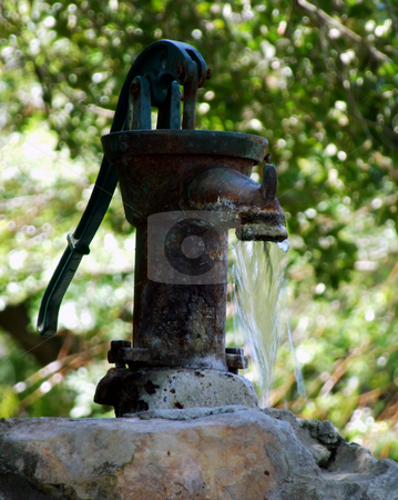 Antique Water Pump stock photo, Antique, hand pump provides running water to a trough. by Marburg