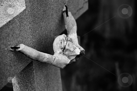 Broken Icon stock photo, Broken figure of jesus Christ on a grave marker by Scott Griessel