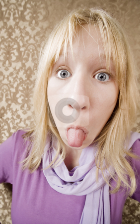 Young girl sticking out her tongue stock photo, Pretty young girl sticking out her tongue by Scott Griessel