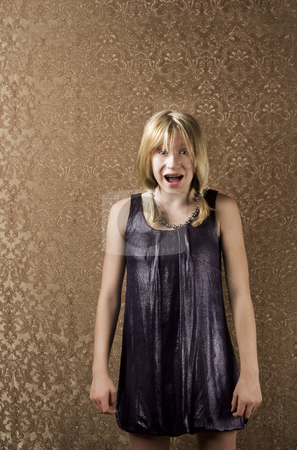 Young blonde girl with braces screams stock photo, Pretty young girl screaming in a party dress by Scott Griessel