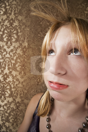 Young bored blonde girl  stock photo, Bored blonde teenager blowing her hair bangs by Scott Griessel