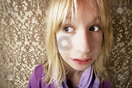 Scared young girl stock photo, Wide angle shot of a frightened young girl by Scott Griessel