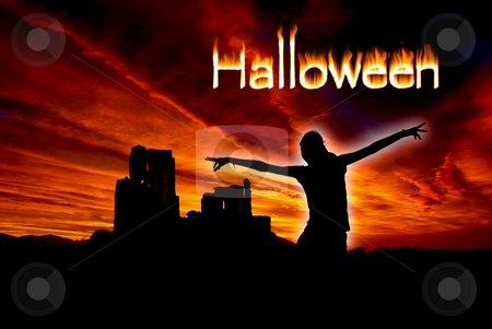Halloween stock photo, Ghost against the ruins of a middle Age castle during Halloween. by Serge VILLA