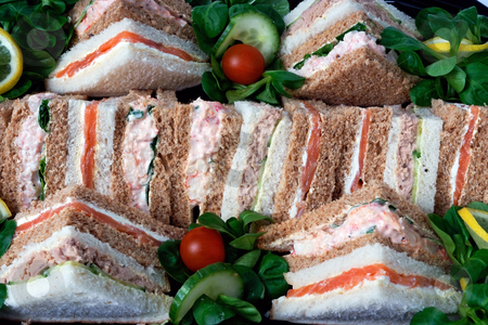 Platter of sandwiches stock photo, A group of sandwiches cut into triangles for a business lunch by Paul Phillips