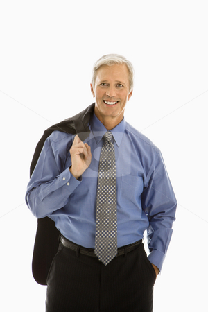 Man in business suit. stock photo, Middle aged Caucasian man in business suit smiling at viewer with jacket draped over shoulder. by Iofoto Images