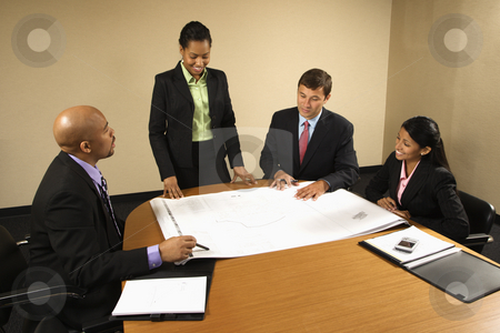 Women and men working. stock photo, Businesspeople having meeting at conference table. by Iofoto Images
