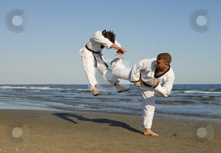 Taekwondo, kickboxing stock photo, Training of the two young men on the beach: taekwondo by Bonzami Emmanuelle